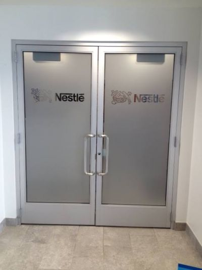 Nestle Frosted Glass Doors with Graphic Logo Cut Outs